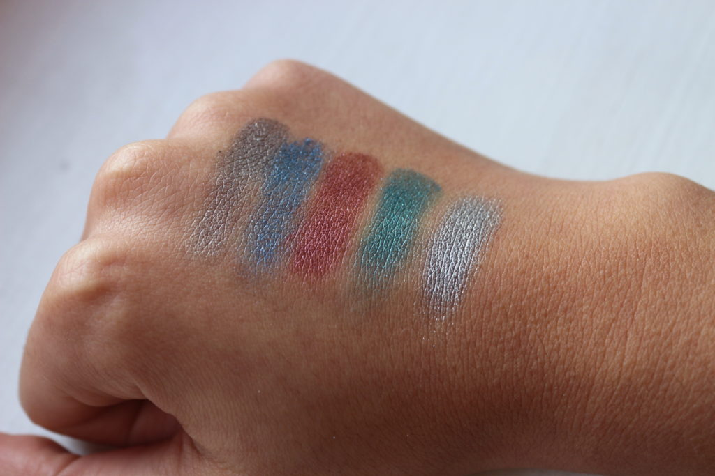 Swatches des fards Aluminium, Dive, Punk Rock, AMP et Glamrock dans la palette Heavy Metals de Urban Decay