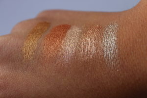 Swatches des fards Glory, Starfire, Angelfire, Maiden et Acoustic dans la palette Heavy Metals de Urban Decay